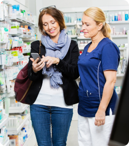 a female pharmacist with a customer