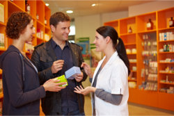 a female pharmacist talking to customers